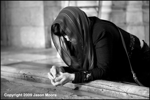 Christian pilgrim praying in Jerusalem.
