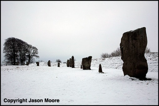 Standing stones in the snow at Avebury Stone circle in Wiltshire.